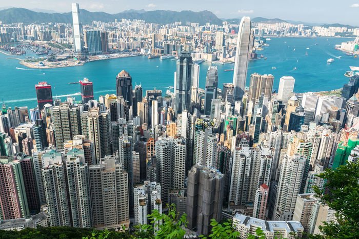 The view of Hong Kong from the Victoria Peak Aerial View Architecture ASIA Building Building Exterior Built Structure City City Cityscape Crowded Downtown District Financial District  High Angle View Hong Kong Kowloon Modern Outdoors Skyscraper Tower Travel Destinations Victoria Peak Water at Victoria Peak, Hongkong The Architect - 2017 EyeEm Awards The Architect - 2017 EyeEm Awards The Architect - 2017 EyeEm Awards Lost In The Landscape