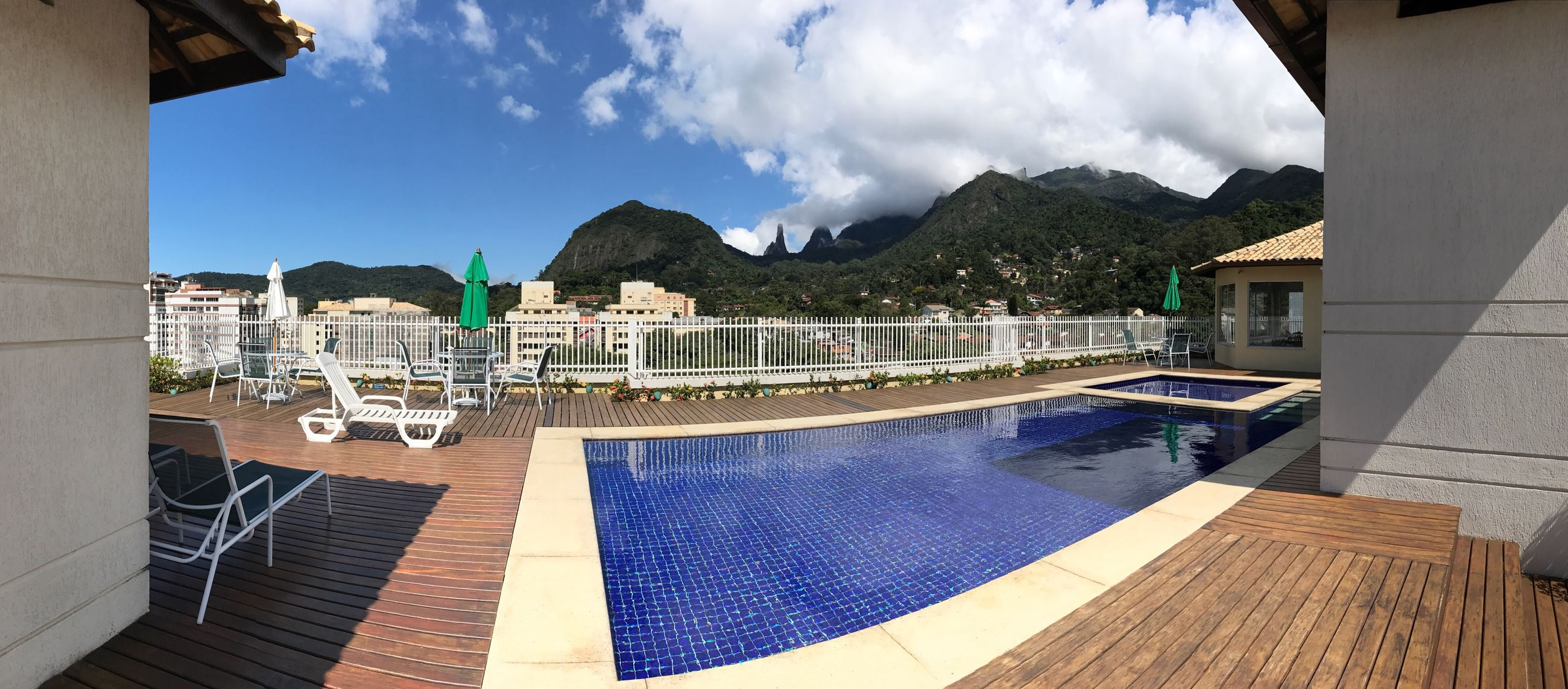 sky, building exterior, architecture, swimming pool, built structure, chair, cloud - sky, outdoors, no people, mountain, tree, day, water, building terrace