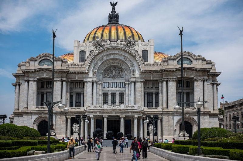 People outside palacio de bellas artes in city