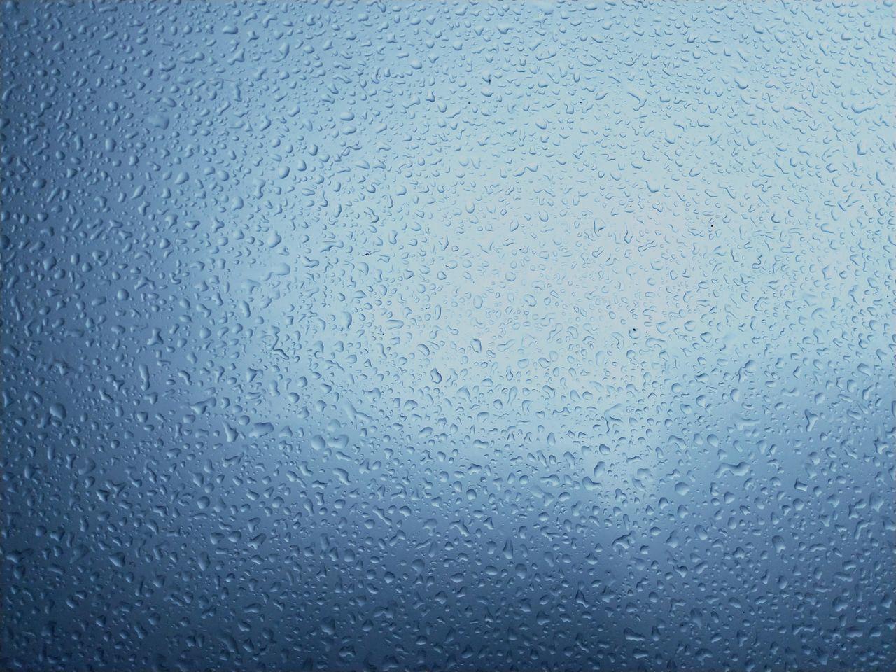 FULL FRAME SHOT OF RAINDROPS ON GLASS
