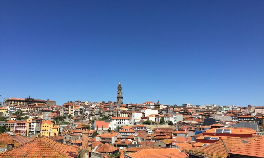 High Angle Shot Of Townscape Against Blue Sky