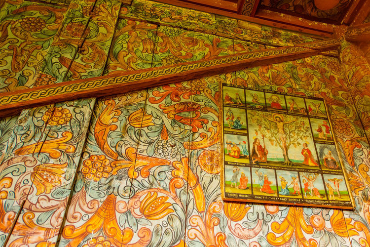 Low angle view of multi colored ceiling in temple