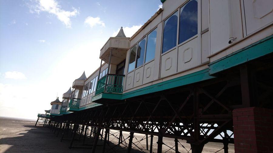 Blue Sky Sand Pier Victorian Wrought Iron Shadow Dramatic Sky Holiday Horizon Over Water Beach Seaside