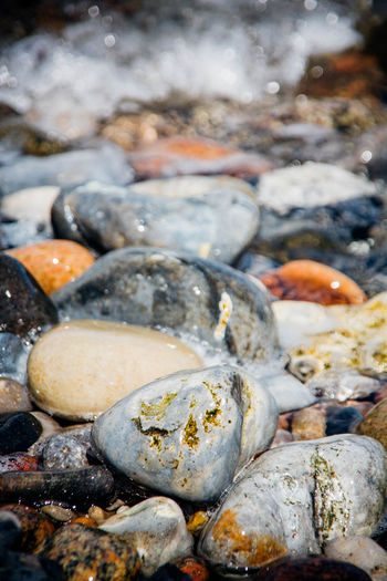 Abundance At Ground Level Beach Focus On Foreground Geology Large Group Of Objects Pebble Pebbles Pebbles And Stones Pebbles And Water Rock Rushing Water Sea Shore Stone - Object Textured  Tidal Tide Water Water Surface