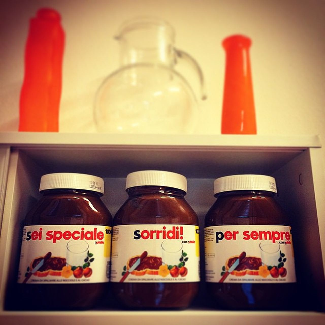 bottle, shelf, indoors, no people, label, jar, food and drink, healthcare and medicine, arrangement, close-up, freshness, food, day