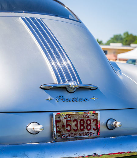 Rearview of the trunk and rear bumper of a 1949 Pontiac Chieftan 2 door Coupe at a classic car show Antique Car Automobile Chieftan Classic Car Pontiac Restoration Car Close-up Day Detail Focus On Foreground Land Vehicle Metal Mode Of Transportation Motor Vehicle No People Nostalgia Outdoors Retro Styled Silver Colored Transportation Vehicle Part Vintage Car