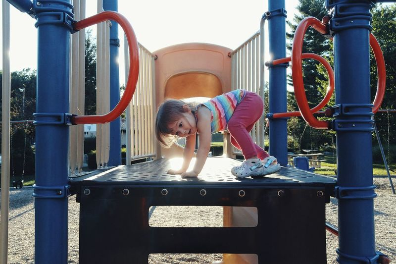 Midsection of a girl on playground