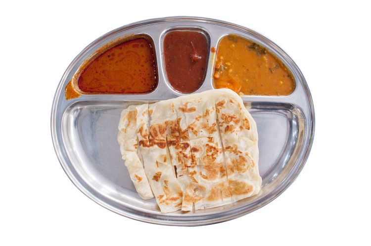 Prata Bread known as Roti Canai in a steel tray with curry isolated over white background view from top. Advertising Beverage Food And Drink Holiday Isolated Teh Tarik Teh Tarik (Malaysian Pull Tea) Travel Bussiness Cropped Cultures Healthy Eating Healthy Lifestyle Indian Food Malaysia Milk Tea People Prata Roti Canai Travel Destinations White Background