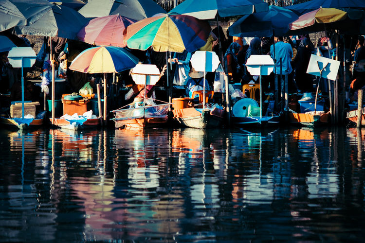 Boats With Parasols Moored In Lake