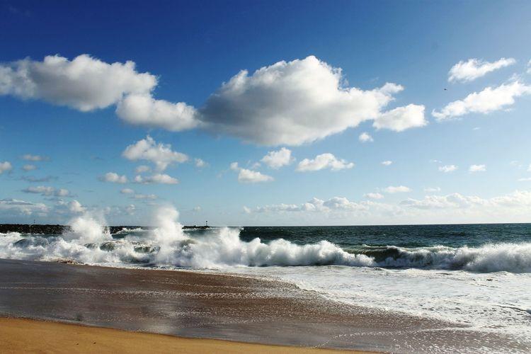 Sea Wave Rushing Towards Shore Against Sky