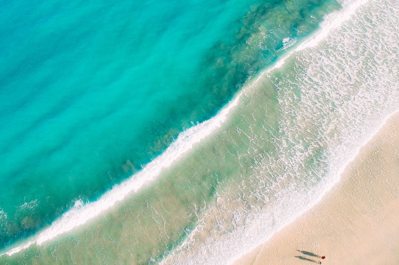 Water Sea Land Beach Sport Motion Sand Wave Aquatic Sport Surfing Nature Day High Angle View Outdoors Beauty In Nature Scenics - Nature Turquoise Colored
