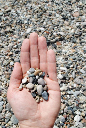 Abundance Close-up Cropped Day Detail Focus On Foreground Holding Human Finger Large Group Of Objects Leisure Activity Lifestyles Nature Outdoors Part Of Pebble Person Personal Perspective Showing Stone - Object Unrecognizable Person