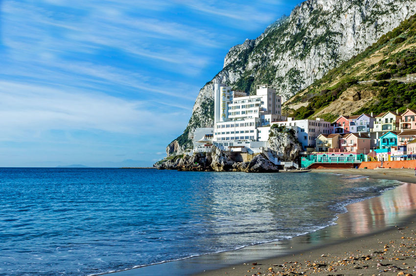 View of Catalan Bay in Gibraltar with the Caleta hotel in the background Caleta Hotel Caleta Hotel Gibraltar Catalan Bay Catalan Beach Gibraltar Landscape Gibraltar Rock Gibraltar Views Gibraltar And Sea Architecture Beach Building Exterior Built Structure Catalan Beach Cloud - Sky Day Gibraltar Horizon Over Water Outdoors Rock - Object Scenics Sea Seafront Houses Sky Water Waterfront