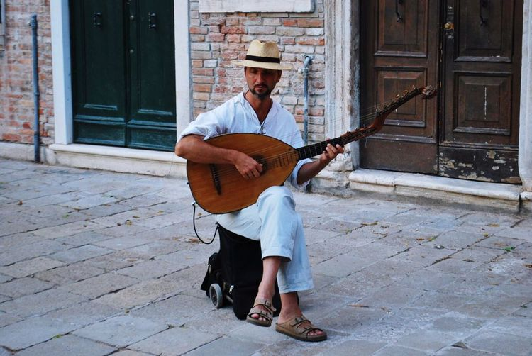 Lute Only Men Playing Music Adults Only Plucking An Instrument Guitar Musical Instrument One Man Only Arts Culture And Entertainment Lifestyles Musician One Person Adult Full Length Men Leisure Activity Brick Wall Sitting Portrait Outdoors Venezia