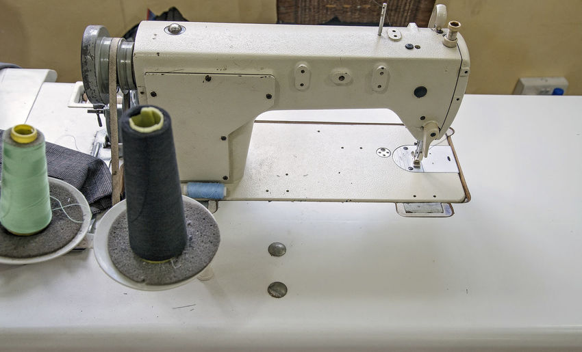 Sewing Machine Machinery Sewing Equipment Metal Thread Manufacturing Equipment Indoors  Industry Textile Close-up Technology Machine Part Textile Industry Spool White Color Needle High Angle View Focus On Foreground Electrical Equipment Entrepreneur