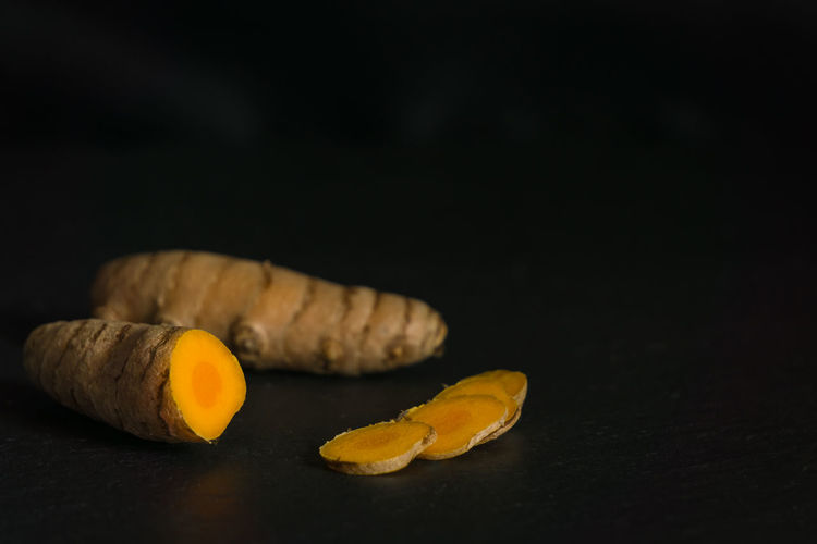 Black Background Black Background Close-up Curcuma Curcuma Longa Curcuma Root Curcumin Curcumin Root Food Food And Drink Freshness Health Healthcare And Medicine Healthy Eating Healthy Food Healthy Lifestyle Indoors  Kurkuma No People Ready-to-eat Root Studio Shot Table Turmeric  Yellow