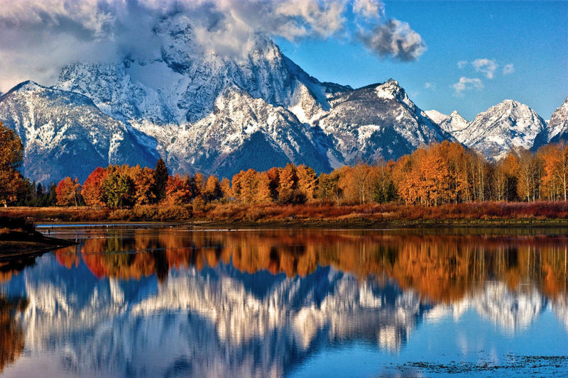 Mount moran reflected in the snake river at oxbow bend  in grand teton national park, wyoming.