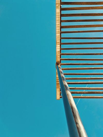Low angle view of structure against blue sky