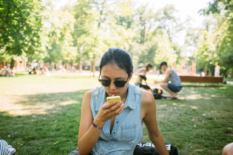 Girl with a Phone in a Park