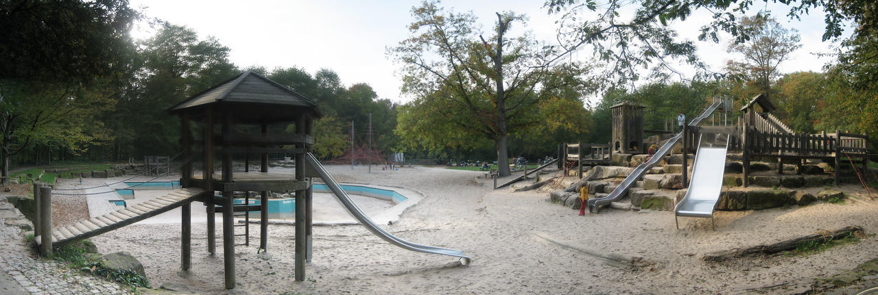 Photos of Karlsruhe, Germany 2006 Beach Day Growth Nature No People Outdoor Play Equipment Outdoors Playground Sand Sky Slide - Play Equipment Tranquility Tree