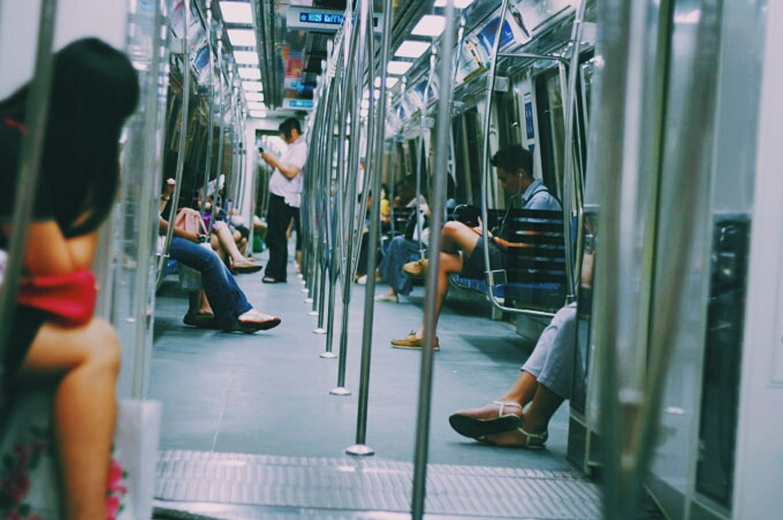 indoors, lifestyles, men, person, leisure activity, escalator, rear view, medium group of people, walking, sitting, full length, casual clothing, technology, low section, standing, city life