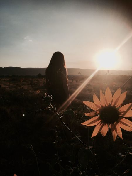 Flower Nature Sunset One Person Beauty In Nature Leisure Activity Real People Women Sky Lifestyles Sun Plant Sunlight Tranquility Young Women Scenics Sitting Young Adult Day
