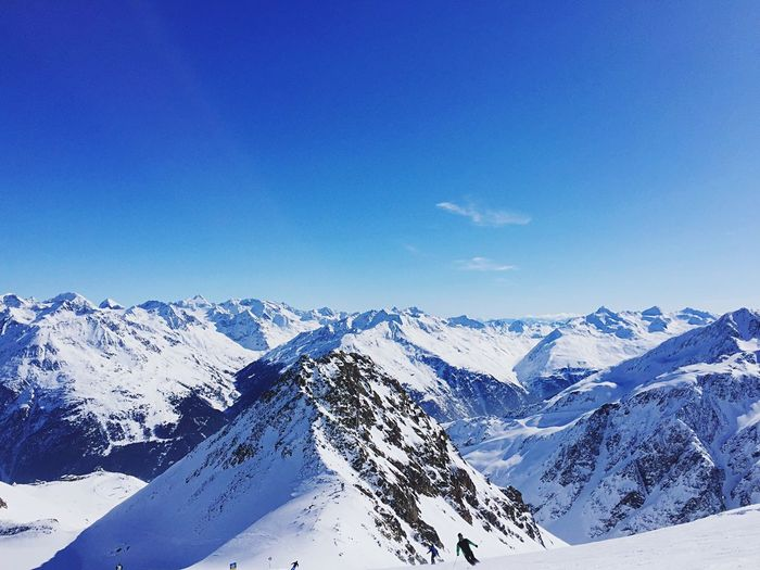 Skiing in Paradise Skiers Winter Holidays Winter Austria Altitude Skiing EyeEm Selects Snow Mountain Cold Temperature Beauty In Nature Nature Snowcapped Mountain Wilderness Area Mountain Range Tranquil Scene Blue Clear Sky