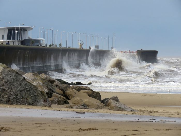 View of waves breaking on the wall