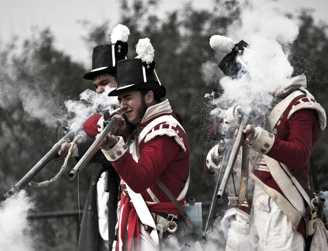 Musketeers Soldier Uniform Adult Day Fire Headwear Helmet Leisure Activity Men Mid Adult Men Musket Musketeer Musketeers Muskets Outdoors People Real People Togetherness Tree War Young Adult