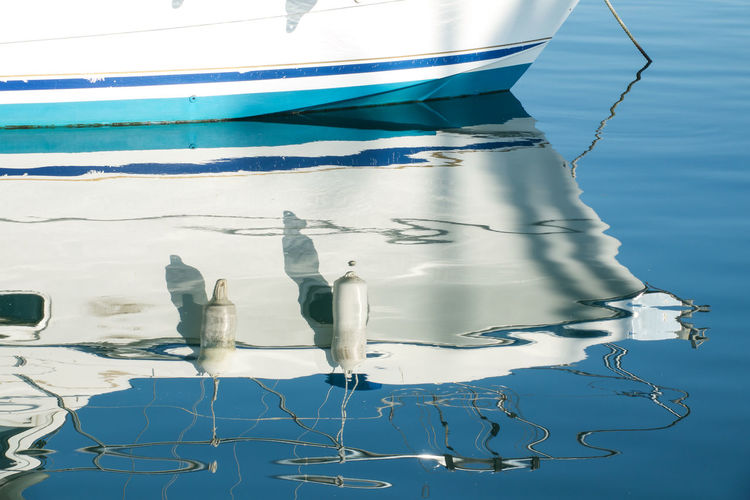 Blue Water Day No People Outdoors Reflection On Water Shimmering Water Water Yacht