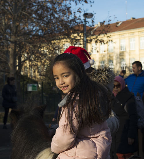 Beauty Child Childhood Close-up Day Enjoyment Family Girls Long Hair Outdoors People Pony Riding Smiling Warm Clothing Winter