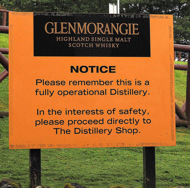 The Glenmorangie distillery who some think produce the finest single malt whisky in Scotland - near Invergordon, Highlands of Scotland Nature Day Field Outdoors Grass Text Communication Close-up Glenmorangie No People Orange Color Invergordon Single Malt Whisky Information Board Western Script Glenmorangie Distillery Scottish Highlands, Scotland, Highlands, Oban, Isles, Colour, Sea, Rocky, Rugged, Slate, Crashing Waves, Surf, Sky, Cloud, Remote, Great Britain, Natural Beauty, Landscape, Seascape, Waves