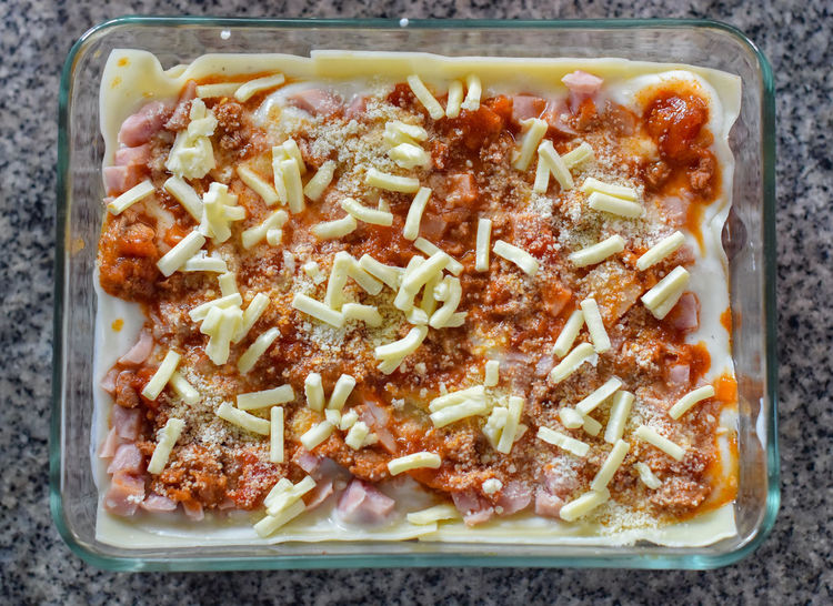 Made lasagna Cooking Food And Drink Homemade Lasagna White Sauce Cheese Close-up Directly Above Food Food And Drink Freshness Healthy Eating High Angle View Indoors  Italian Food Kitchen Utensil No People Still Life Tray