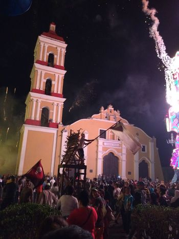 Iglesia de Remedios en medio de la celebración de las Parrandas Adult Architecture Building Exterior Celebration City Illuminated Night Outdoors People Religion Sky Spirituality