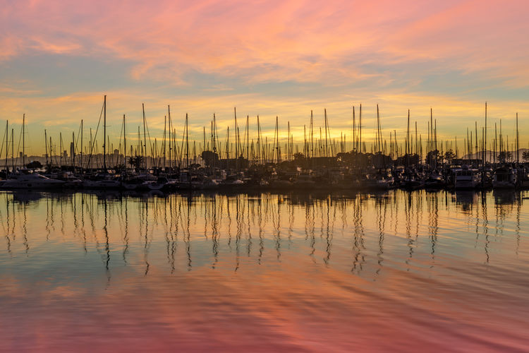 Colors of Emeryville Marina. Alameda County, California, USA. Water Sunset Reflection Cloud - Sky Sky Harbor Sailboat Moored Mode Of Transportation Nautical Vessel No People Transportation Orange Color Waterfront Beauty In Nature Mast Pole Nature Tranquility Marina Outdoors Yacht Emeryville California San Francico Bay