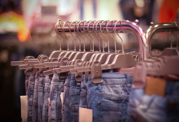 Close-up of jeans for sale in store