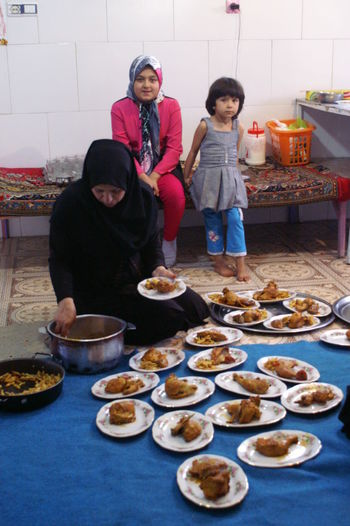 a fantastic Iranian family prepares lunch for us International Women's Day 2019 Women Food Togetherness Family Preparation  Group Of People Preparing Food Table Females