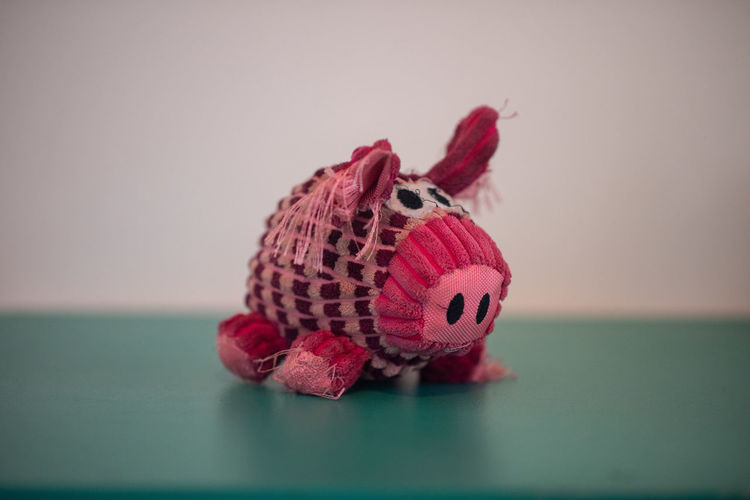 Ms Piggy Indoors  Close-up Toy Animal Representation Selective Focus No People Representation Animal Single Object Pink Color Studio Shot Still Life Animal Themes Red Table Mammal Creativity Focus On Foreground Colored Background Art And Craft Piggy