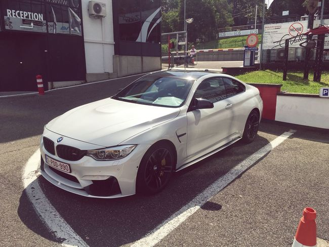 BMW M4 Transportation Car Land Vehicle Mode Of Transport Road Street City Roadside City Street Day City Life Outdoors Bmw M4 Circuit Zolder