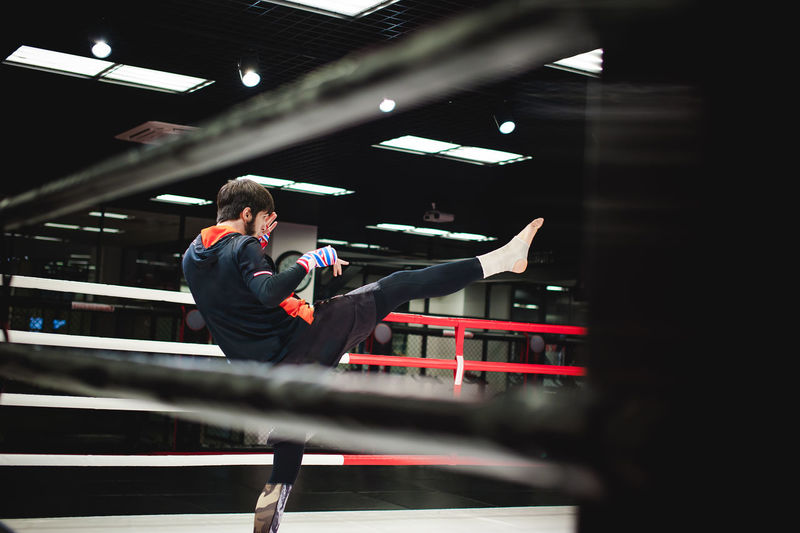 Man practicing boxing in ring