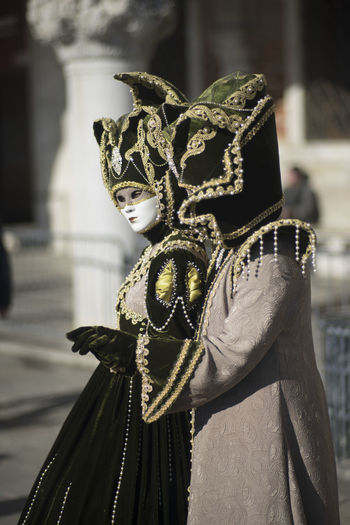 People wearing mask and costume during carnival