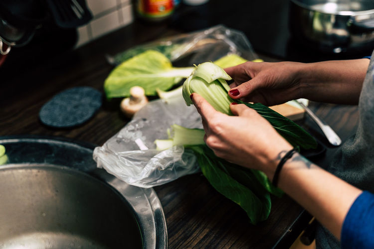 Pak Choy Chef Cutting Food Food And Drink Freshness Hand Healthy Eating Holding Human Body Part Human Hand Indoors  Kitchen Lifestyles Midsection One Person Preparation  Preparing Food Real People Vegetable Women