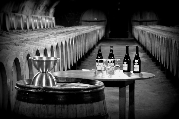 Beverage Classic Food And Drink Glasses Industry Wine Bottle Wine Tasting Arrangement Barrels Beauty Of Food Cellar Focus On Foreground Monochrome Table Wine Wine Love Wine Lovers Wine Production Wineglass An Eye For Travel