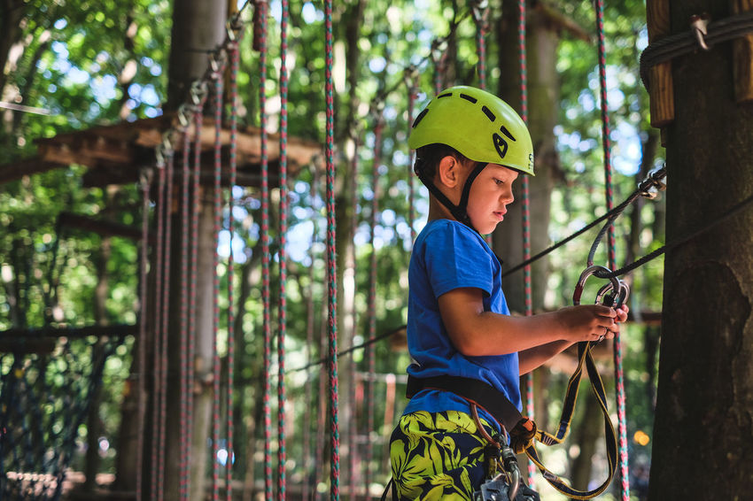 FUJIFILM X-T10 Vacations Boys Child Childhood Day Forest Fujifilm Headwear Helmet Land Leisure Activity Males  Men One Person Outdoors Plant Protection Real People Rope Safety Safety Harness Sport Tree Wasiak