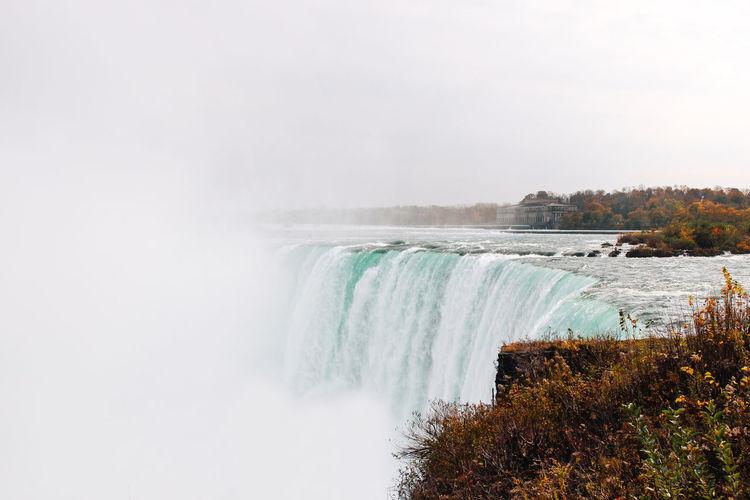 Scenic View Of Niagara Falls Against Sky