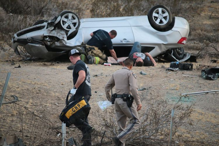 The arrival of the CHP to the scene of a single car rollover accident on route 62 (29 Palms Highway) with one injury Accident Coachella Valley Crash Helping Highway Injury Policeman Riverside County Volunteer Firefighter