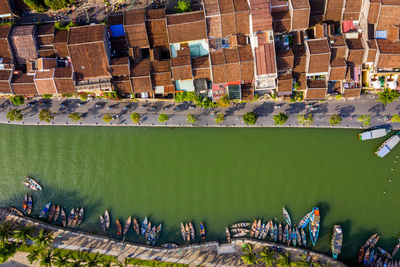 Drone view of river by buildings