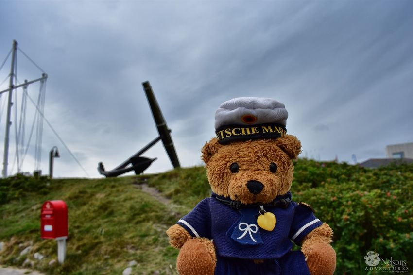 Nelson in Thorsminde. In background the anchor of the HMS St. George. NelsonsAdventures Anchor Thorsminde Denmark Denmark 🇩🇰 Teddy Teddy Bear Stuffed Toy Landscape Landscape_Collection Travel Traveling Seeing The Sights Nikon EyeEm Masterclass EyeEm Nature Lover Sightseeing Vacations Close-up Summer Weather Headwear Seaman Toy Mailbox