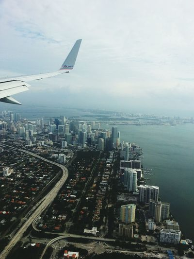 Descending upon Miami. From An Airplane Window Maimi Cityscape Traveling RePicture Travel