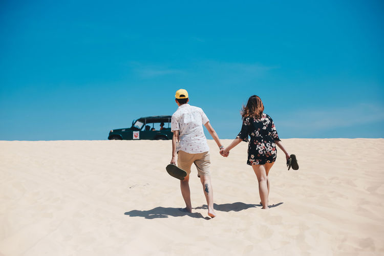 Love no boundaries. Couple Dessert Hot Love Relationship Sunny Adult Backview Blue Couple - Relationship Full Length Goal Land Lifestyles Outdoors People Real People Rear View Sand Sky Sunlight Tattoo Togetherness Two People Women